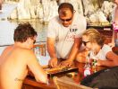 Backgammon as the sun sets in Aperlai Bay